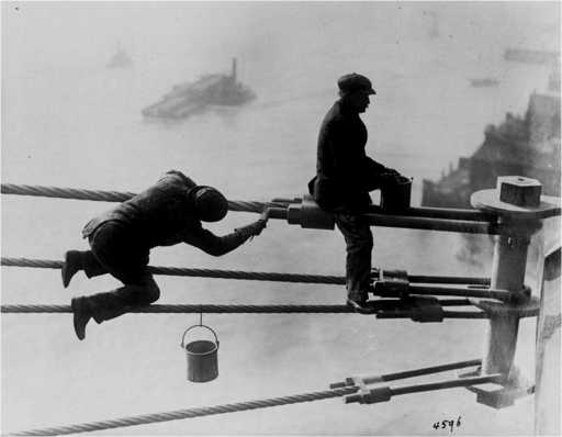 Brooklyn_Bridge_painters_at_work_high_above_New_York_City,_on_03_December_1915.png